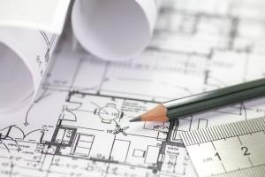 bigstock-Architect-rolls-and-plans-67465795-300x200